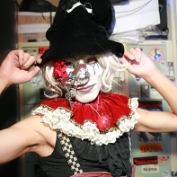 Eren in one of his jester outfits wearing a white wig.