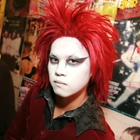 Japanese DJ Teru with red hair and white facepaint.
