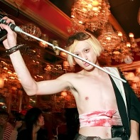 Shirtless blonde guy with a plastic katana.