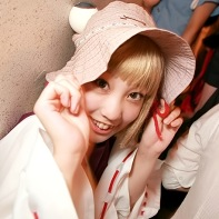 Japanese cosplay girl with a wide-brimmed hat.