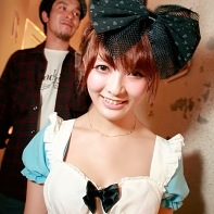 Japanese girl wearing housemaid uniform and oversized bow.