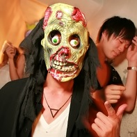 Guy with a scary zombie mask.