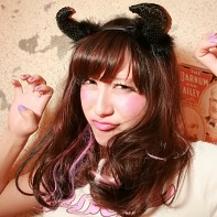 Brown-haired Japanese girl making a scary pose.