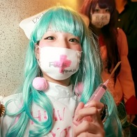 Japanese girl with turquoise wig in a crazy nurse costume.