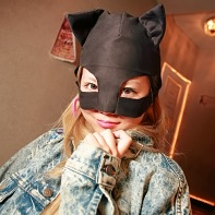 Japanese girl wearing a black hood with cat's ears.