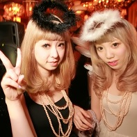 Two blonde Japanese ladies dressed as black angel and white angel.