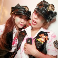 Two blood-covered policewomen with latex uniforms.