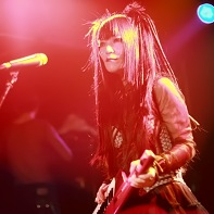 Vocalist Nekoi Psydoll playing her keyboard guitar.
