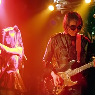 Guitarist Ucchi in front of his Psydoll band mates Uenoyama/Loveless and Nekoi.