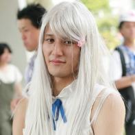 A male cosplayer dressed up as Atsumu 'Yukiatsu' Matsuyuki disguised as Meiko 'Menma' Honma from the AnoHana (あの日見た花の名前を僕達はまだ知らない) anime series.