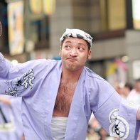 A man doing the traditional 'silly dance' at the Kōenji Awa Odori.
