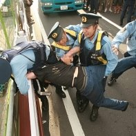An anti-nuke activist desperately tries to keep the police from arresting him.