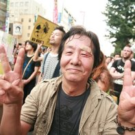 A Japanese man injured by the police still determined to continue protesting.