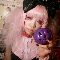Another costumed goth girl with a pink wig and blue contacts.