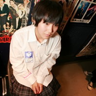 Japanese girl with a plaid skirt and white shirt.