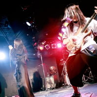 A shot of guitar player Suijo with his bandmates Ryo☆キラリーン and Peat in the background.