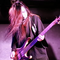 Peace To Pieces' bassist Peat playing at the Club Theatic Show 22 event.