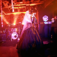Japanese goth band Remnant on stage: guitarist Takmi, singer Marie and narrator Rober_tJ.
