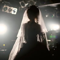 The end of the performance: Marie in backlight.