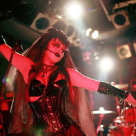 Japanese singer Ageha dancing during the Zwecklos concert.