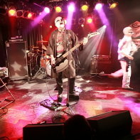 Japanese metal band Hernia 44 on the stage of the Live Inn Rosa: keyboardist Tsuyoshi, singer and bassist Hirohisa Nagao (Thunder) and guitarist Multico.