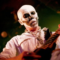 Guitar player Multico Honekawa of Hernia 44 with skeleton skull make-up.
