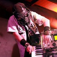 The keyboard player Tsuyoshi of Hernia 44 wearing a gas mask during the concert.