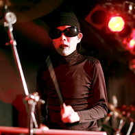 Psydoll's percussionist and theremin player Uenoyama performing.