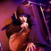 Vanished Empire's Dee Lee singing in his black cowl.