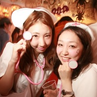 Two other girls wearing nurse outfits at the Halloween party.
