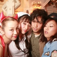 Japanese DJ Takeru with three female friends in the White Room.