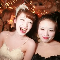 Two Japanese girls cosplaying in black and white Black Swan costumes.