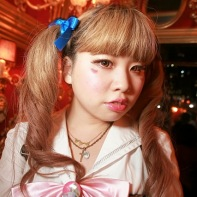 A fashionable Japanese girl with pigtails and large brown circle contact lenses.