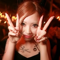 Another girl with scarily large big-eye contact lenses.
