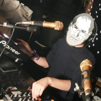 One of the DJs wearing a Steve Jobs mask due to the recent death of the Apple co-founder.