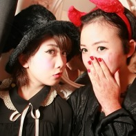 Two Japanese girls dressed in black for the Mysterious Halloween Night event.