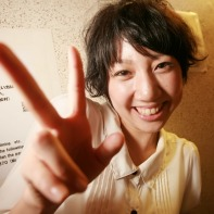A happy Japanese girl making the v-sign.