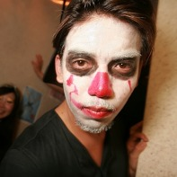 A kakoi Japanese guy with white and red facepaint for Halloween.