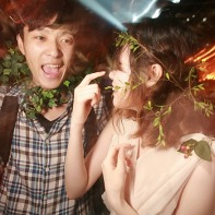 A Japanese couple with ivy wreaths dancing in the Trump Room club.
