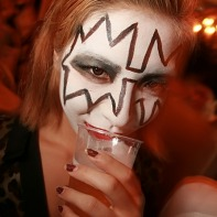 Japanese girl with make-up inspired by Kiss' lead guitarist Ace Frehley.