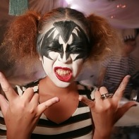 Another girl posing as a Kiss member (this time Gene Simmons).