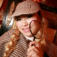 A Japanese girl wearing a fitting Sherlock Holmes costume to the Mysterious Helloween Night.