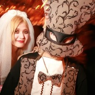A couple in some very strange fashions at the Mysterious Halloween party.