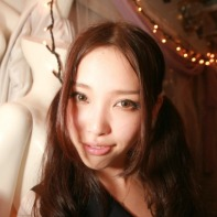 Close wide angle portrait of a Japanese party girl.