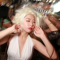 Japanese girl dressed up as Marilyn Monroe for Halloween.