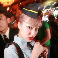 Japanese girl in an old-school flight attendant's costume at the Noir Halloween party.