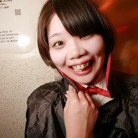 Japanese girl with Dracula's cape.