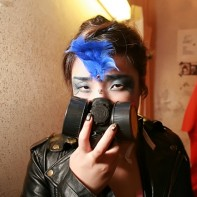Japanese girl in leather jacket and filter mask.