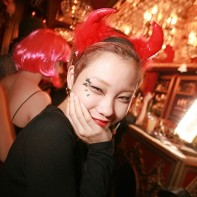 Smiling Japanese girl with devil's horns in the Trump Room.