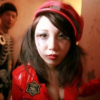 Japanese girl with a red PVC police uniform.